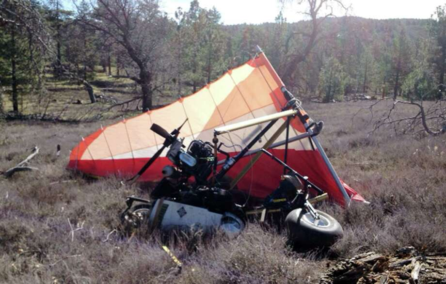 This image provided Saturday March 22, 2014, by U.S. Immigration and Customs Enforcement (ICE), shows a crash site Friday where Federal authorities said an ultralight aircraft carrying about 250 pounds of marijuana crashed in the mountains east of San Diego. Photo: Uncredited, AP / AP2014