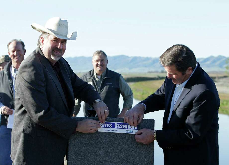 In this photo taken Wednesday March 19, 2014, Republican Rep. Doug LaMalfa, left, and Democratic Rep. John Garamendi, display a bumper sticker supporting the building a new reservoir in the Sites Valley, during a news conference near Maxwell, Calif.  California's drought has sparked a new push by federal lawmakers to create or expand a handful of reservoirs around the state. Photo: Rich Pedroncelli, AP / AP