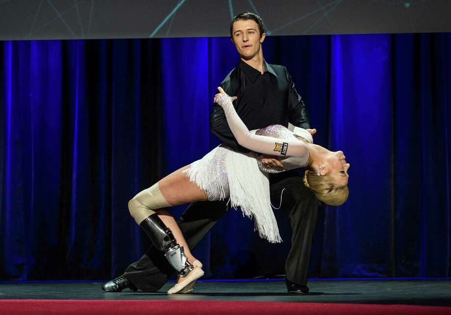 In this photo provided by TED 2014 Conference, dancer Adrianne Haslet-Davis, front, performs on stage with dancer Christian Lightner at the 2014 TED Conference, Wednesday, March 19, 2014, in Vancouver, British Columbia. Haslet-Davis took to the stage to perform for the first time since losing part of her left leg in the 2013 Boston Marathon bombing. Photo: James Duncan Davidson, AP / AP2014