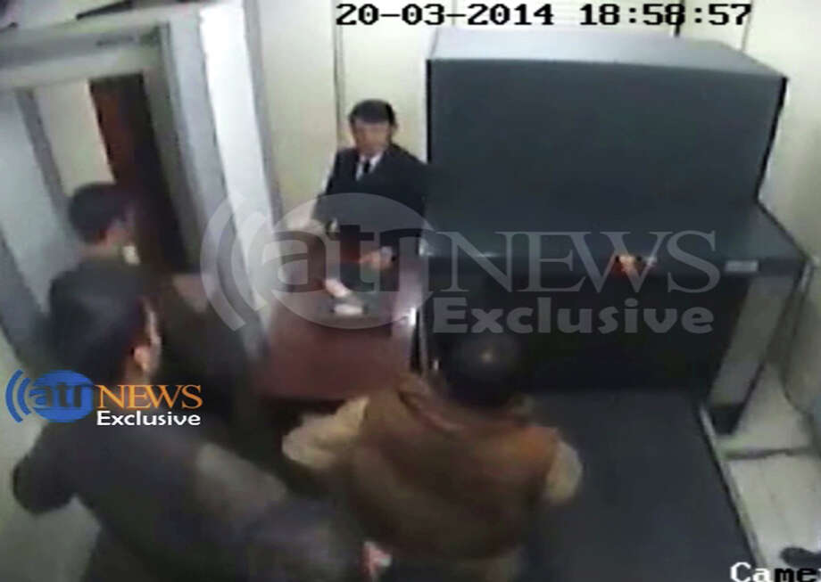 In this frame grab provided from a video by Ariana Television News, four attackers entering the second security check at the Serena hotel in Kabul, Afghanistan, Thursday, March 20, 2014. A closed-circuit security video shows security guards searching four attackers twice before allowing them to enter an Afghan hotel where the young men proceeded to the restaurant and killed nine diners, including four foreigners and two children. The footage was broadcast Saturday, March 22, 2014 by a local Afghan TV station and shared with The Associated Press. The question of how the gunmen penetrated the Serena hotel's tight security is one of the biggest mysteries surrounding Thursday's attack. Authorities say the weaponry was hidden in their shoes. Photo: Uncredit, AP / Ariana Television News