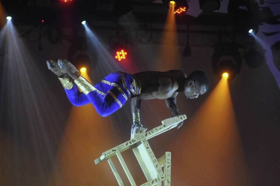 "An acrobat performs during the ""Mother Africa"" show on opening day at Dollywood in Pigeon Forge, Tenn. Friday March 21, 2014. Photo: Curt Habraken, AP / The Mountain Press"