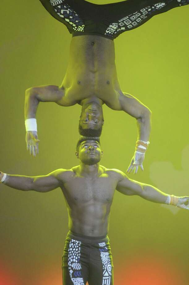 "A pair of acrobats perform during the ""Mother Africa"" show on opening day at Dollywood in Pigeon Forge, Tenn. Friday March 21, 2014. Photo: Curt Habraken, AP / AP2014"