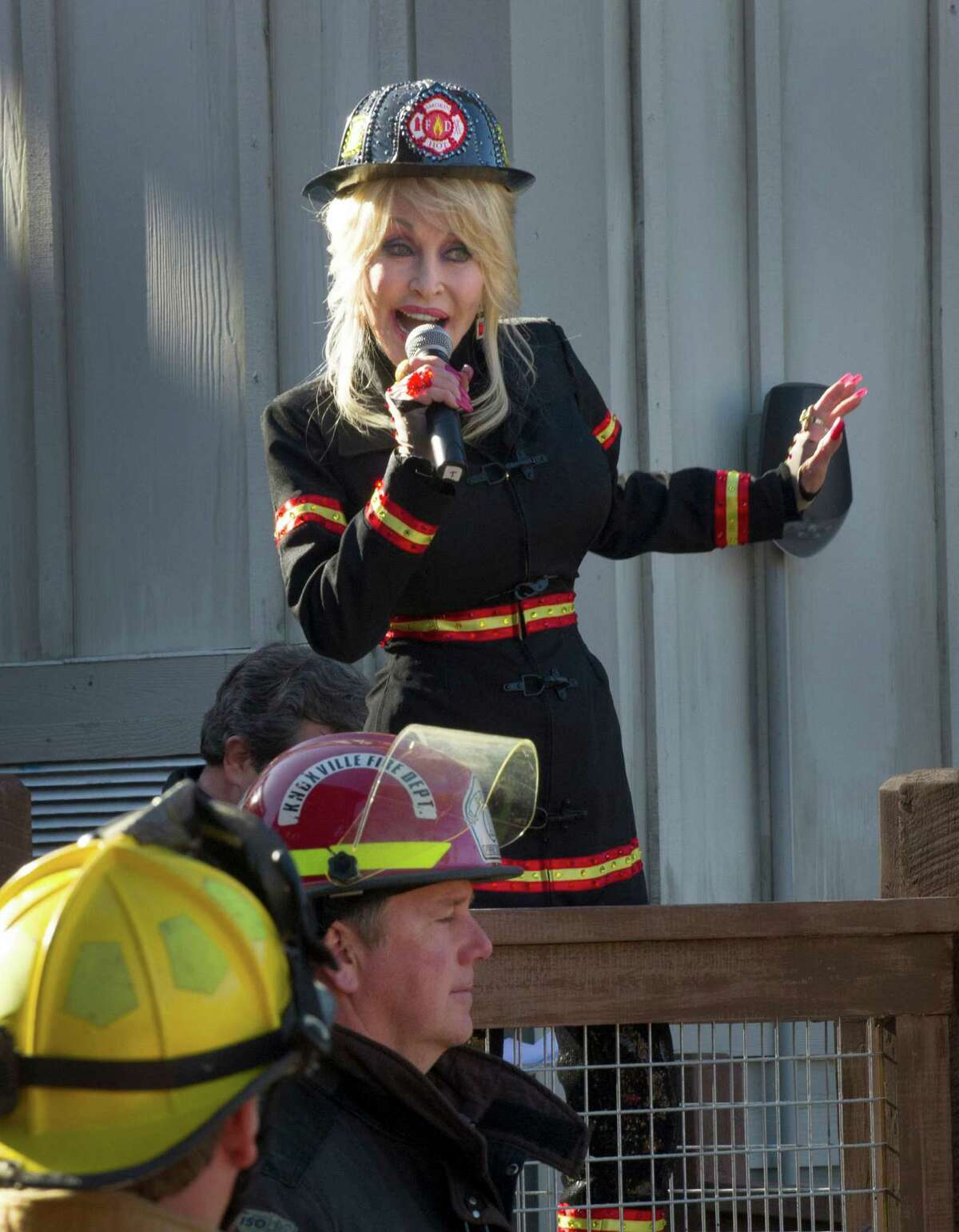 Dolly Parton introduces the new FireChaser Express roller coaster to kick off the opening of Dollywood's 29th season Friday, March 21, 2014, in Pigeon Forge, Tenn. The $15 million FireChaser Express is a dual launch roller coaster designed to look like firefighting trains used in the Smoky Mountains in the 1940s.