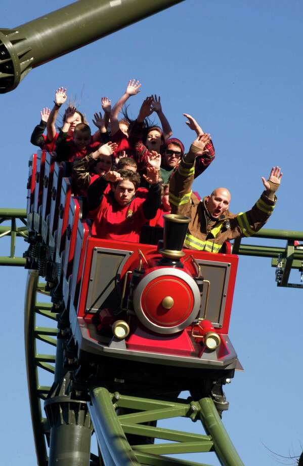 Visitors enjoy the new FireChaser Express roller coaster to kick off the opening of Dollywood's 29th season Friday, March 21, 2014, in Pigeon Forge, Tenn. The $15 million FireChaser Express is a dual launch roller coaster designed to look like firefighting trains used in the Smoky Mountains in the 1940s. Photo: Michael Patrick, AP / AP2014