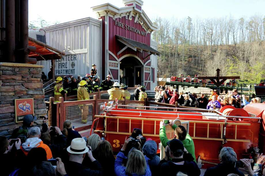 Dolly Parton introduces the new FireChaser Express roller coaster to kick off the opening of Dollywood's 29th season Friday, March 21, 2014, in Pigeon Forge, Tenn. The $15 million FireChaser Express is a dual launch roller coaster designed to look like firefighting trains used in the Smoky Mountains in the 1940s. Photo: Michael Patrick, AP / AP2014