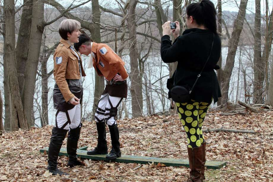 Anime enthusiasts, from left, Jess Costello, of West haven, Lawrence Reinhardt, of Milford, and Sarah Hammer, of Trumbull, shoot a still for fun at Boothe Memorial Park in Stratford, Conn. on Sunday, March 23 , 2014. Reinhardt struggles to keep a serious face. Anime refers to Japanese animation and is an art form using emerging technologies. Photo: BK Angeletti, B.K. Angeletti / Connecticut Post freelance B.K. Angeletti