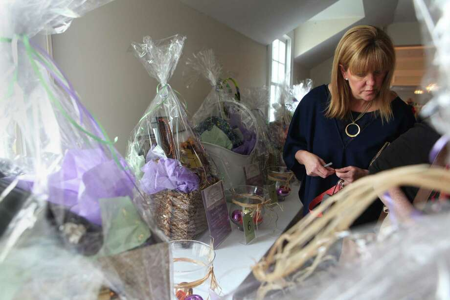 "Christie Charles browses at the St. Joseph High School ""Shop Til You Drop Ladies Luncheon"" at the Brooklawn Country Club in Fairfield, Conn on Sunday, March 23, 2014. The event benefits St. Joseph High School in Trumbull and the Parent Association. Photo: BK Angeletti, B.K. Angeletti / Connecticut Post freelance B.K. Angeletti"