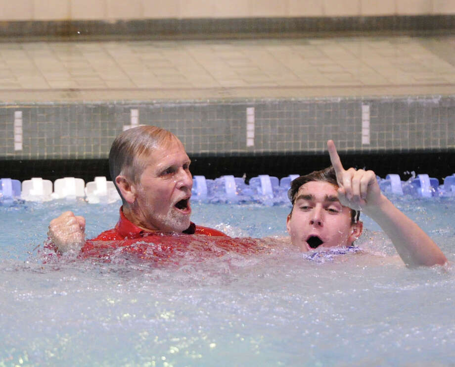 At left, Greenwich High School swim coach, Terry Lowe, reacts as he takes a dip in the pool with Greenwich swimmer Julian Fraser after his team won the State Open Boys High School Swimming Championships at Yale University, New Haven, Conn., Saturday, rch 22, 2014. Photo: Bob Luckey / Greenwich Time