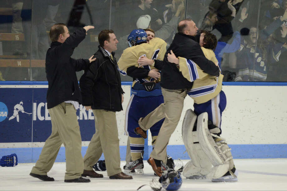 Newtown players celebrate at the end of the game as Newtown High School beats E.O. Smith-Tolland High School in Division III state finals at Ingalls Rink in New Haven, CT on Sat., March 22, 2014. Photo: Shelley Cryan / Danbury News-Times freelance/Shelley Cryan