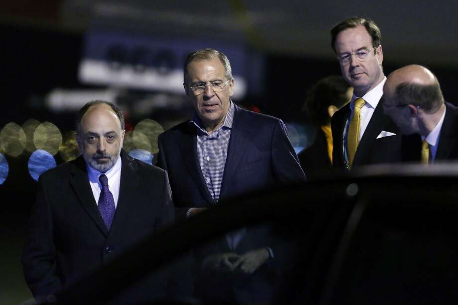 Russian Foreign minister Sergei Lavrov (C) arrives at Schiphol airport in Amsterdam on March 23, 2014 ahead of the March 24-25 Nuclear Security Summit (NSS) in The Hague. AFP PHOTO/POOL/FRANCOIS LENOIRFRANCOIS LENOIR/AFP/Getty Images Photo: Francois Lenoir, AFP/Getty Images
