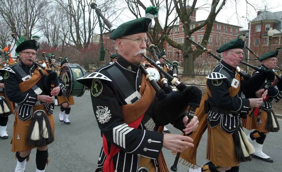 Donald Hicks, of South Kent, plays the bagpipes while marching in the Danbury St. Patrick's Day Parade, on March 23, 2014. Hicks plays with the Celtic Cross Pipes and Drums of Danbury, Conn. Photo: H John Voorhees III / The News-Times Freelance