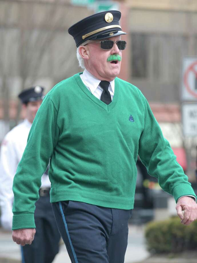 Executive Lieutenant Bill McAllister, from Wooster Hose Company #5, in Danbury, Conn, marches in the Danbury St. Patrick's Day Parade, March 23, 2014. McAllister dyed his mustache green for St. Patrick's Day, just as he has for the past 30 years. Wooster Hose marched in the parade celebrating its 125th year anniversary. Photo: H John Voorhees III / The News-Times Freelance