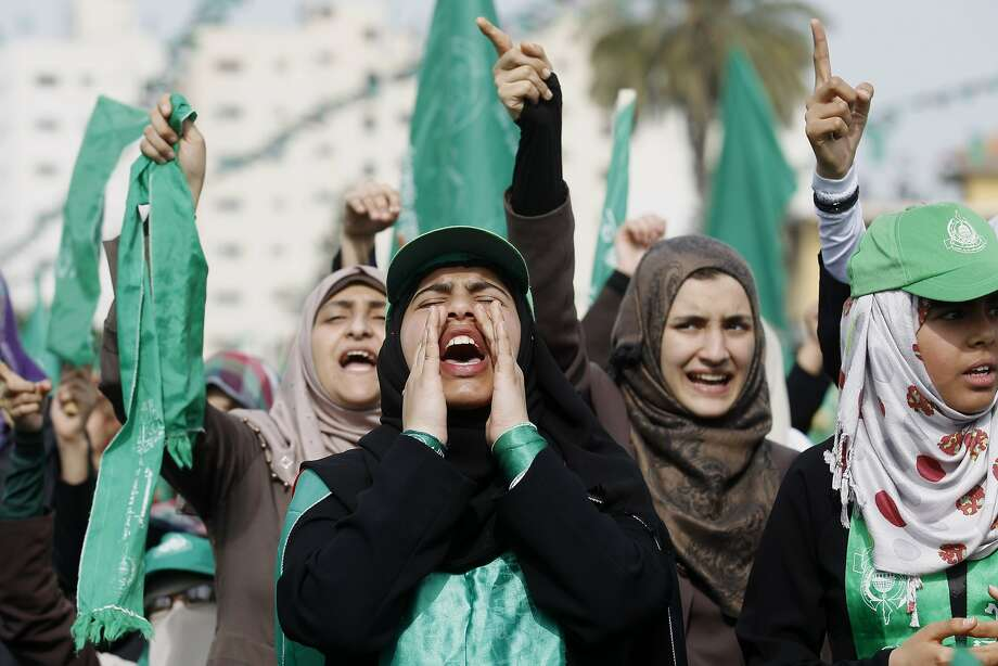 Backers of Hamas rally on the streets of downtown Gaza City to commemorate the 10th anniversary of the killing of its spiritual leader, Sheikh Ahmed Yassin. Photo: Said Khatib, AFP/Getty Images