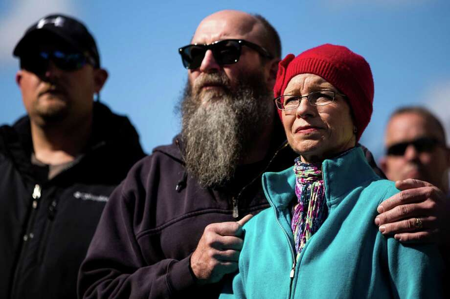Snohomish County residents listen to Governor Jay Inslee address a crowd during a mudslide update at a media availability segment Sunday, March 23, 2014, outside of the Arlington Police Department in Arlington, Wash. Authorities say 18 people are unaccounted for after a massive mudslide killed at least three people and destroyed 30 homes, forcing evacuations from fears of the Stillaguamash River flooding. Photo: JORDAN STEAD, SEATTLEPI.COM / SEATTLEPI.COM