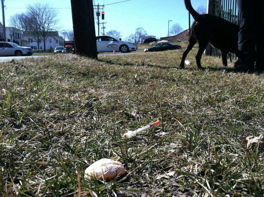 A discarded syringe lay in the grass along Elm Street Extension outside Center Cemetery in New Milford on Tuesday, March 18, 2014. Photo: Denis O'Malley / The News-Times