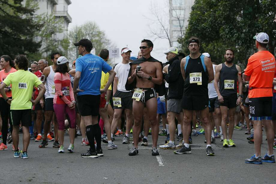 Runners line up to start the marathon during the 5th annual Oakland Running Festival on March 23, 2014 in Oakland, Calif. Thousands of people of all ages came out to enjoy the day and participate in the various running events. Photo: Codi Mills, The Chronicle