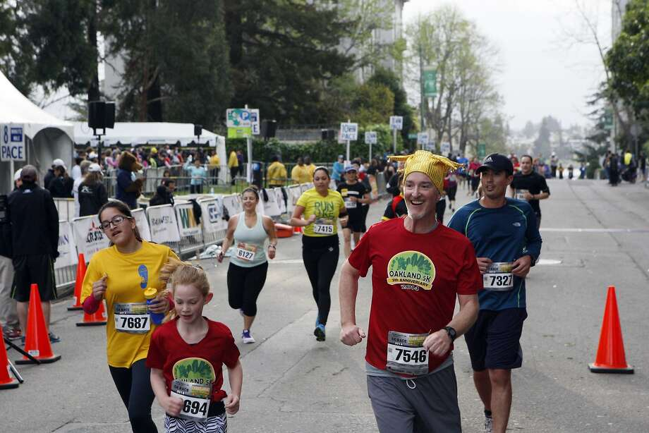 People of all ages ran across the finish line for the 5k run during the 5th annual Oakland Running Festival on March 23, 2014 in Oakland, Calif. Thousands of people from different states came out to enjoy the day and participate in the various running events. Photo: Codi Mills, The Chronicle