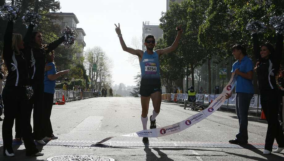 David Torrence finishes strong during the 5th annual Oakland Running Festival on March 23, 2014 in Oakland, Calif. Thousands of people of all ages came out to enjoy the day and participate in the various running events. Photo: Codi Mills, The Chronicle
