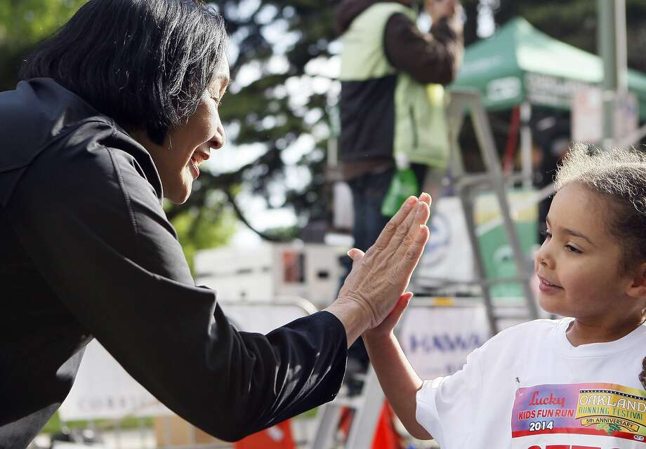 Mayor of Oakland Jean Quan (left) high fives Aliyah, 3, (right) after the kid's fun run during the 5th annual Oakland Running Festival on March 23, 2014 in Oakland, Calif. Thousands of people of all ages came out to enjoy the day and participate in the various running events. Photo: Codi Mills, The Chronicle