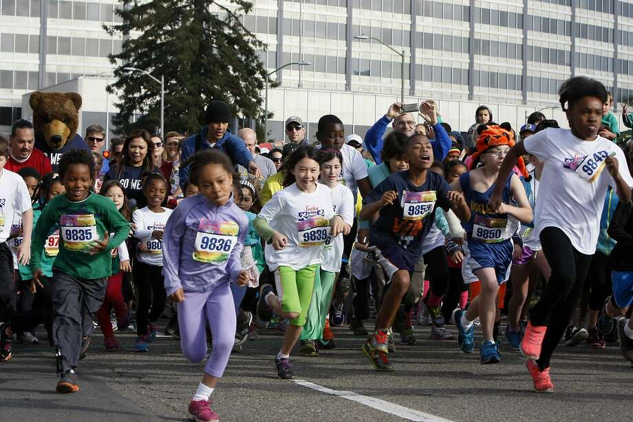 Kids take off from the starting line of the kids' fun run during the 5th annual Oakland Running Festival on March 23, 2014 in Oakland, Calif. Thousands of people of all ages came out to enjoy the day and participate in the various running events. Photo: Codi Mills, The Chronicle