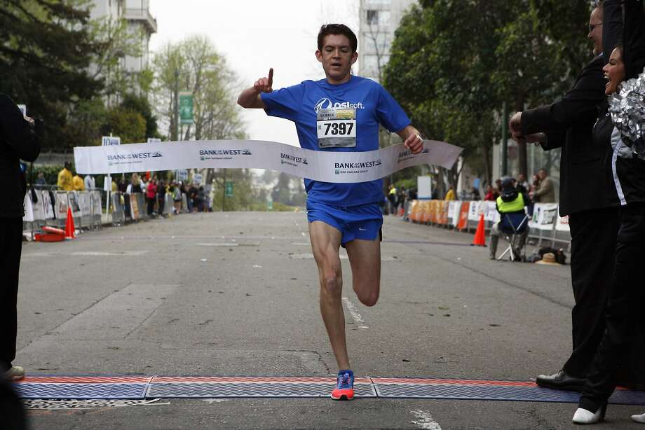 Daniel Lopez, 26, blows through the finish line after the 5k race during the 5th annual Oakland Running Festival on March 23, 2014 in Oakland, Calif. Thousands of people of all ages came out to enjoy the day and participate in the various running events. Photo: Codi Mills, The Chronicle