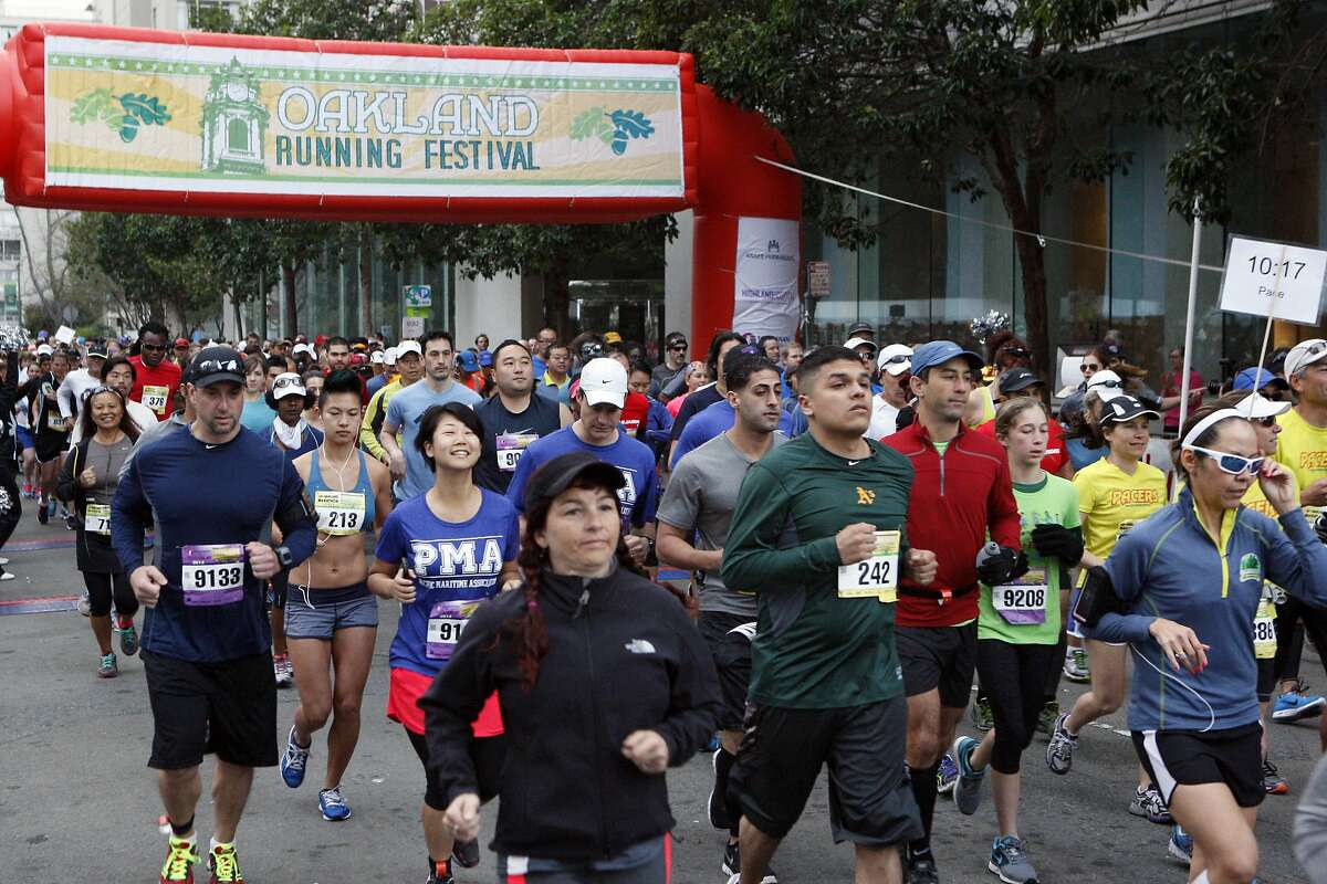 People begin the marathon during the 5th annual Oakland Running Festival on March 23, 2014 in Oakland, Calif. Thousands of people of all ages came out to enjoy the day and participate in the various running events.