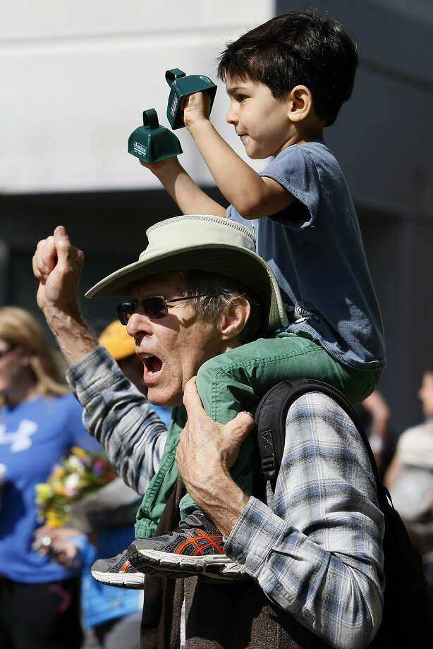 Peter Waring, 69, holds Ishaan Chander-Waring, 3, during the 5th annual Oakland Running Festival on March 23, 2014 in Oakland, Calif. Thousands of people of all ages came out to enjoy the day and participate in the various running events. Photo: Codi Mills, The Chronicle