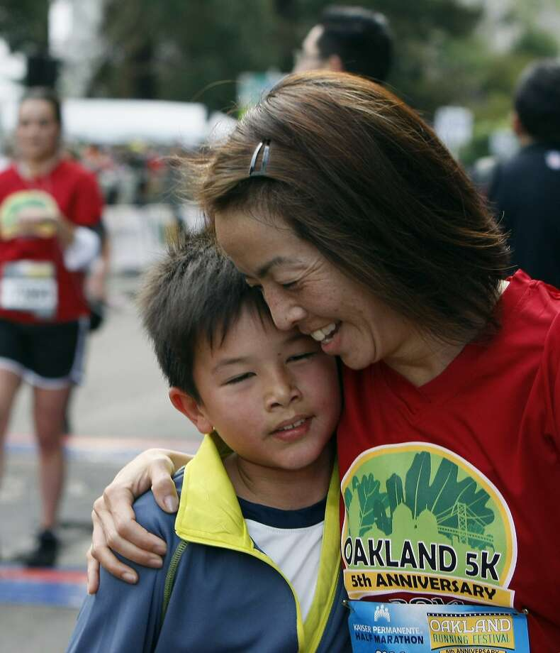 Betty Bredemann, 45 (right) hugs Kai Bredemann, 9, (left) during the 5th annual Oakland Running Festival on March 23, 2014 in Oakland, Calif. Thousands of people of all ages came out to enjoy the day and participate in the various running events. Photo: Codi Mills, The Chronicle
