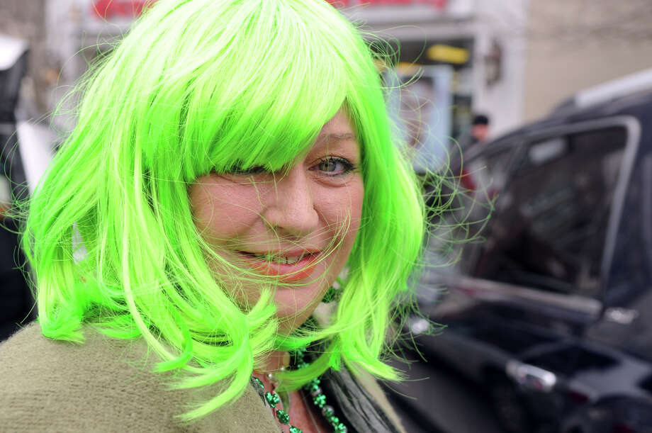 Anne Marie Friar goes green during Greenwich's St. Patrick's Day Parade in Greenwich, Conn., March 23, 2014. The parade sets off from the Town Hall and finishes at the bottom of Greenwich Avenue. Photo: Keelin Daly / Stamford Advocate Freelance
