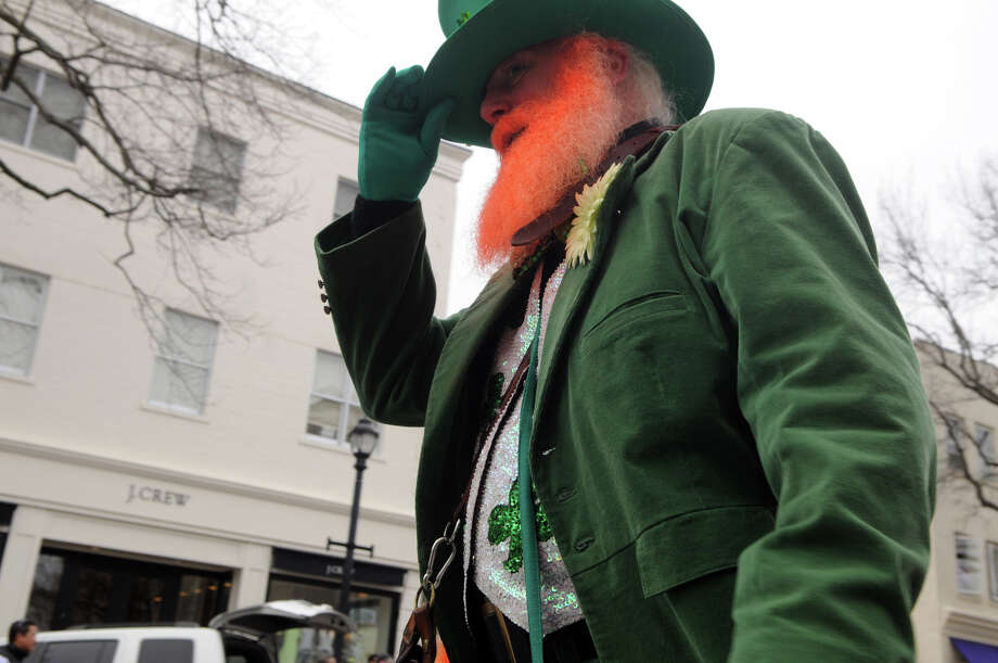 A Leprechaun makes the scene during Greenwich's 40th St. Patrick's Day Parade in Greenwich, Conn., March 23, 2014. The parade sets off from the Town Hall and finishes at the bottom of Greenwich Avenue. Photo: Keelin Daly / Stamford Advocate Freelance