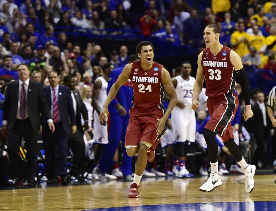 Seniors Josh Huestis (24) and Dwight Powell exult after the 10th-seeded Cardinal knocked off the second-seeded Jayhawks in the Round of 32 in St. Louis. Photo: Scott Rovak, Reuters