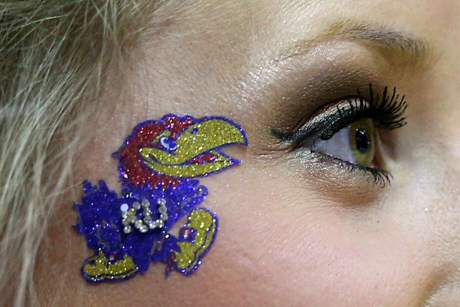 ST LOUIS, MO - MARCH 23:  A Kansas Jayhawks cheerleader looks on during a break against the Stanford Cardinal in the third round of the 2014 NCAA Men's Basketball Tournament at Scottrade Center on March 23, 2014 in St Louis, Missouri. Photo: Andy Lyons, Getty Images / 2014 Getty Images