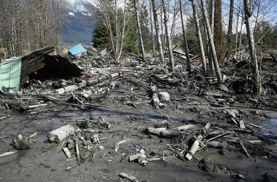 A house is seen destroyed in the mud on Highway 530 next to mile marker 37 on Sunday, March 23, 2014, the day after a giant landslide occurred near mile marker 37 near Oso, Washington.  At least six homes have been washed away, with three people reported dead so far and at least eighteen missing. The nearby Stillaguamish River has been dammed up by 15-20 feet of debris as a result, creating more flooding concerns, as reported by KING 5 via the state hydrologist. Photo: Lindsey Wasson, AP / The Seattle Times Pool