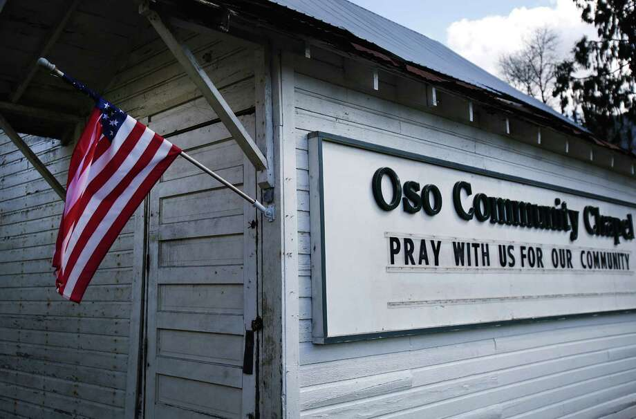 "The Oso Community Church displays a sign reading ""pray with us for our community"" in Oso off of Highway 530 on Sunday, March 23, 2014, the day after a giant landslide occurred near mile marker 37. At least six homes have been washed away, with three people reported dead so far and at least eighteen missing. The nearby Stillaguamish River has been dammed up by 15-20 feet of debris as a result, creating more flooding concerns, as reported by KING 5 via the state hydrologist. Photo: LINDSEY WASSON, AP / The Seattle Times Pool"