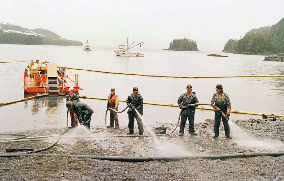 Workers attempt to cleanup a beach in the wake of the Exxon Valdez oil spill. Photo: John Gaps III, AP / AP