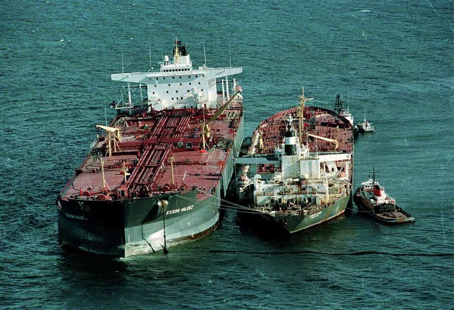 Tugboats hold the tanker Exxon Baton Rouge, right, up against the tanker Exxon Valdez as oil is pumped out of the damaged tanker that ran aground into the Prince William Sound, 25 miles from Valdez, Alaska, March 28, 1989.  Exxon Valdez ran aground March 24, spilling over 270,000 barrels of crude oil. Photo: JACK SMITH, ASSOCIATED PRESS / AP1989