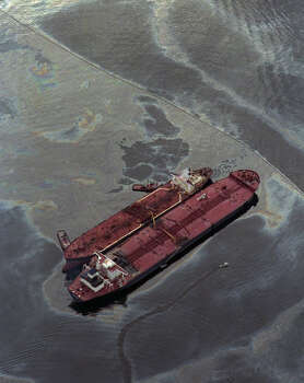 The Exxon Baton Rouge, smaller ship, attempts to off load crude oil from the Exxon Valdez in Prince William Sound, Alaska on March 26, 1989. The ship ran aground spilling more than 270,000 barrels of crude oil. Experts call it the United State's worst oil spill ever. Photo: Anonymous, ASSOCIATED PRESS / AP1989