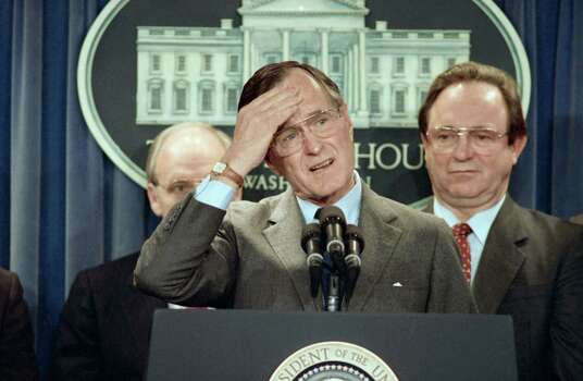 President George H. Bush puts his hand to his head while discussing the Exxon Valdez oil tanker spill tragedy in Alaska during a White House press conference, Friday, April 7, 1989 in Washington. Photo: Marcy Nighswander, ASSOCIATED PRESS / AP1989