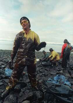 Bill Scheer, of Valdez, Alaska, is covered in crude oil while working on a beach fowled by the spill of the tanker Exxon Valdez at Prince William Sound, Wednesday afternoon, April 13, 1989.  Efforts to clean the 10.9 million gallons of  North Slope crude oil continue. Photo: JOHN GAPS III, ASSOCIATED PRESS / AP1989