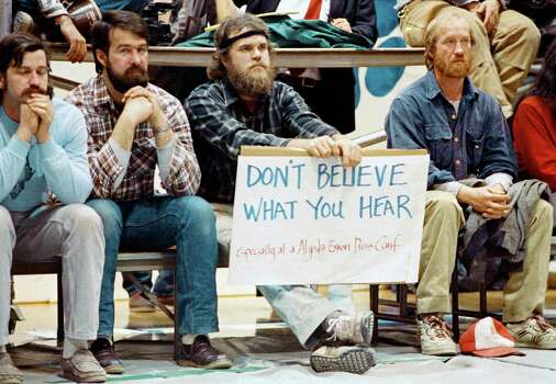Three unidentified men listen to Exxon Oil officials, in Cordova, Alaska on March 29, 1989, talk about the millions of gallons of oil that spilled from one of their tankers after it ran aground in Prince William Sound. Photo: Rob Stapleton, ASSOCIATED PRESS / AP1989