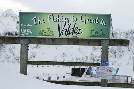 In this photo taken Feb. 26, 2014, is a sign hanging outside the small boat harbor in Valdez, Alaska. When the Exxon Valdez ran aground in March 1989, spilling nearly 11 million gallons of crude in Prince William Sound, many fisheries were hurt by the disaster and many fishermen lost boats or homes. Photo: Mark Thiessen, AP / AP