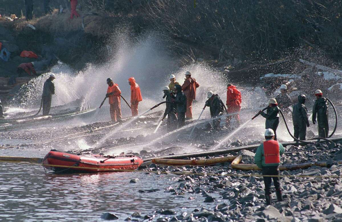 In this April 21, 1989 file photo, crews use high pressured hoses to blast the rocks on this beach front on Naked Island, Alaska. This is one of only two beaches that are being worked on, of the 58 beaches in the Prince William Sound. On March 24, the crude oil tanker Exxon Valdez grounded on a reef and spilled nearly 11 million gallons of oil in the waters. Nearly 25 years after the Exxon Valdez oil spill off the coast of Alaska, some damage heals, some effects linger in Prince William Sound.