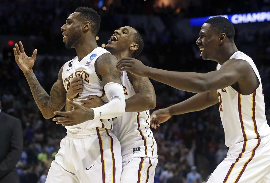 DeAndre Kane (left) is congratulated by teammates Monte Morris (center) and 