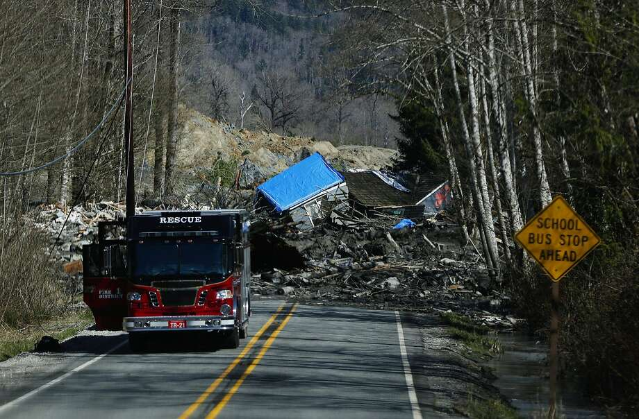 The wreckage of a house destroyed by the wall of mud lies on Highway 530. The slide hit near two small towns about 55 miles north of Seattle, wiping out about 30 homes. Photo: Lindsey Wasson, McClatchy-Tribune News Service