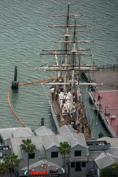 Protective boom surrounds tall ship Elissa at the Port of Galveston on Sunday, March 23, 2014, in Galveston, Texas. Dozens of ships are in evolved in clean-up efforts to remove oil that spilled into Galveston Bay after a ship and barge collided near the Texas City dike on Saturday afternoon. Photo: Smiley N. Pool, Houston Chronicle / © 2014  Houston Chronicle