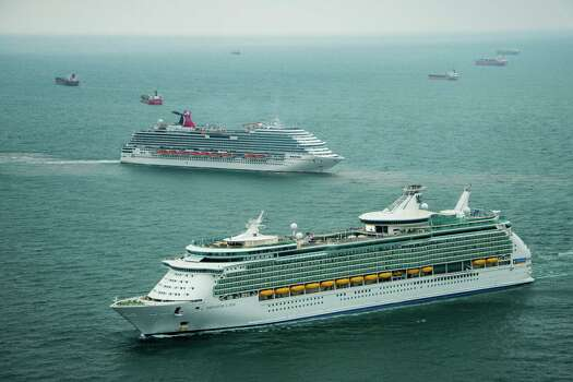 The Royal Caribbean Navigator of the Seas and the Carnival Magic sit idle with dozens of other ships off the coast of Galveston, Texas on Sunday, March 23, 2014. At least 33 vessels, including two cruise ships, are waiting to enter the Houston Ship Channel from the Gulf of Mexico after a ship and barge collided near the Texas City dike on Saturday afternoon. Photo: Smiley N. Pool, Houston Chronicle / © 2014  Houston Chronicle