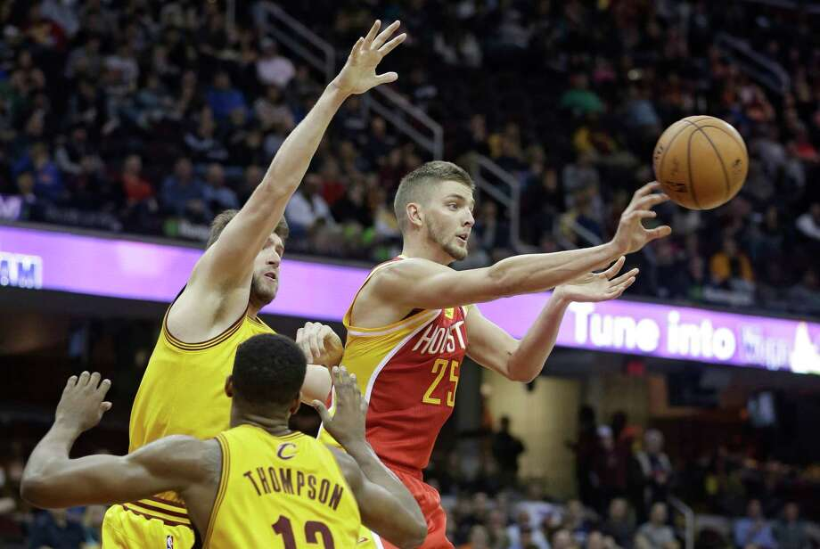 Chandler Parsons, right, passes out of a double team by the Cavaliers' Spencer Hawes, left, and Tristan Thompson on Saturday night, when Parsons had six of the Rockets' 31 assists. Photo: Tony Dejak, STF / AP