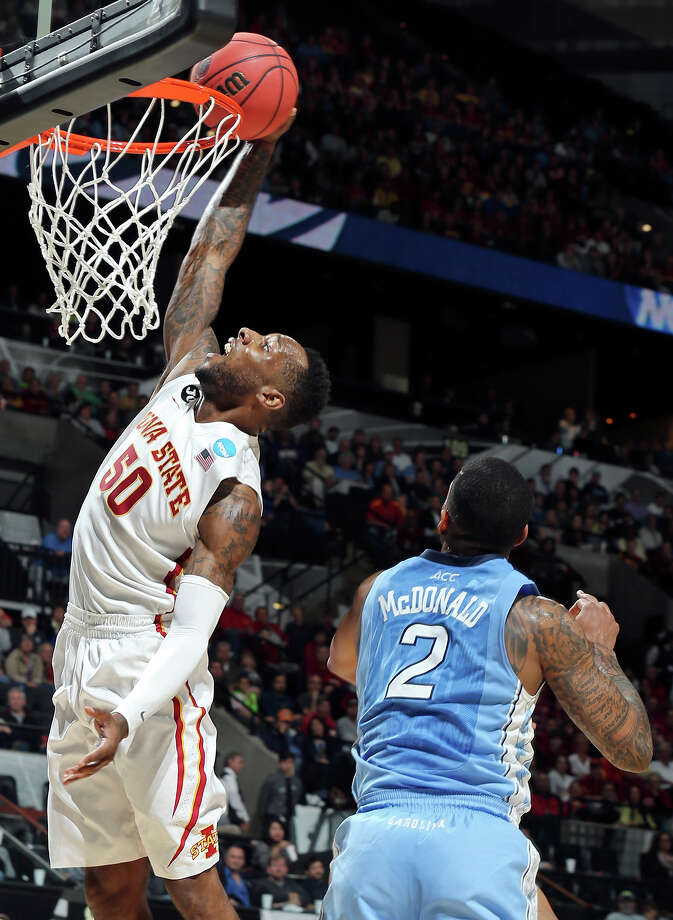 Iowa State's DeAndre Kane (50) goes up for a dunk around North Carolina's Leslie McDonald (02) during first half action of their third round 2014 NCAA Division I Men's Basketball Championship tournament game held Sunday March 23, 2014 at the AT&T Center. Photo: Edward A. Ornelas, San Antonio Express-News / © 2014 San Antonio Express-News
