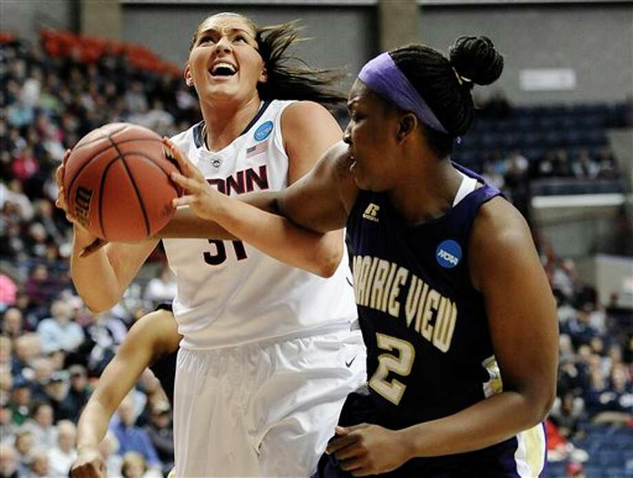 Prairie View A&M's  Shamiya Brooks, right, fouls Connecticut's Stefanie Dolson, left, during  the first half of a first-round game of the NCAA women's college  basketball tournament, Sunday, March 23, 2014, in Storrs, Conn. (AP  Photo/Jessica Hill)