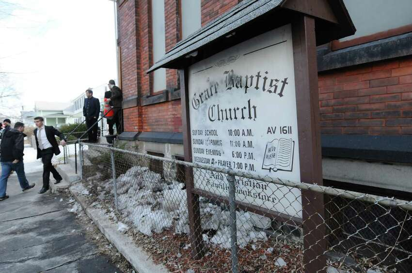 People arrive for service at Grace Baptist Church on Sunday, March 23, 2014, in Troy, N.Y. A drawing was held after service and a modified AR-15 rifle was given away. (Paul Buckowski / Times Union)